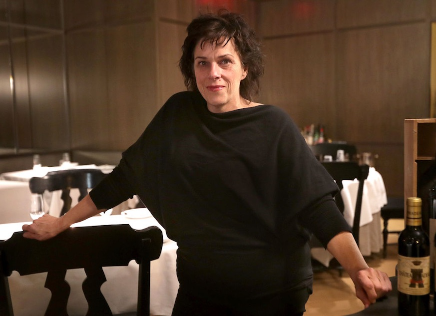 Barbara Lynch poses for a portrait in the dining room of her restaurant Menton in Boston on Nov. 9, 2016. (Photo by John Blanding/The Boston Globe via Getty Images