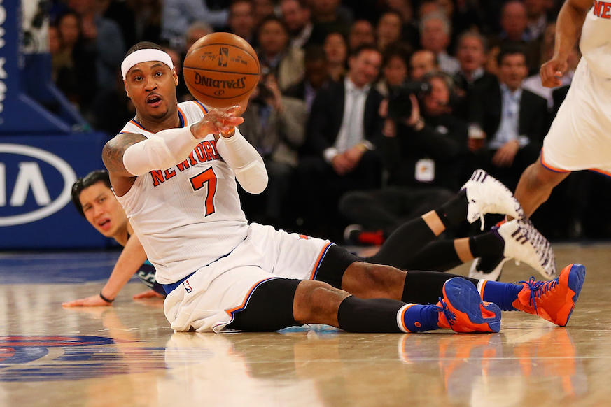 Knicks star Carmelo Anthony recovers a loose ball and looks to start the break.