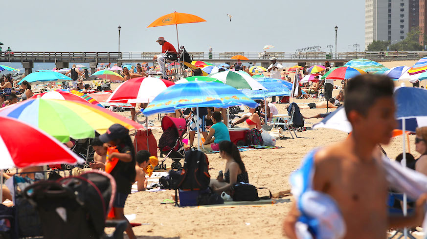 You'll still have to leave your beach towel, but Domino's will deliver almost to the beach. Credit: Getty Images